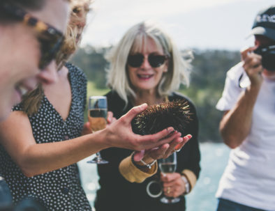 Guests hold sea urchins on Deep-to-Dish: Tasmanian Seafood Experience