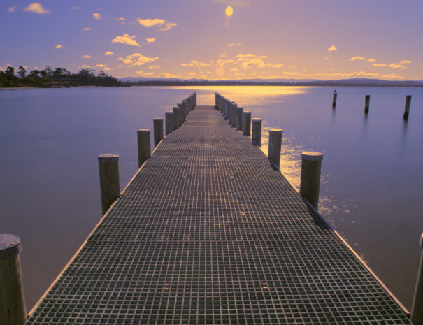 Pier on the water in the town of Swansea, Tasmania during the day.